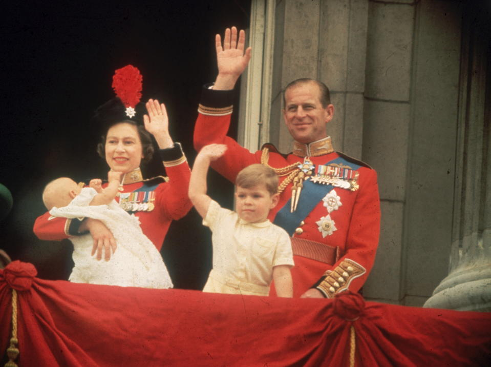 Queen Elizabeth, Prince Philip, Prince Andrew and Prince Edward waving to the crowds from the balcony at Buckingham Palace, during the Trooping of the Colour.    (Photo by Fox Photos/Getty Images)