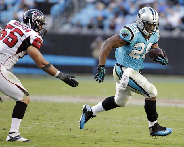 Carolina Panthers' Jonathan Stewart (28) runs past Atlanta Falcons' Paul Worrilow (55) in the second half of an NFL football game in Charlotte, N.C., Sunday, Nov. 3, 2013. (AP Photo/Bob Leverone)