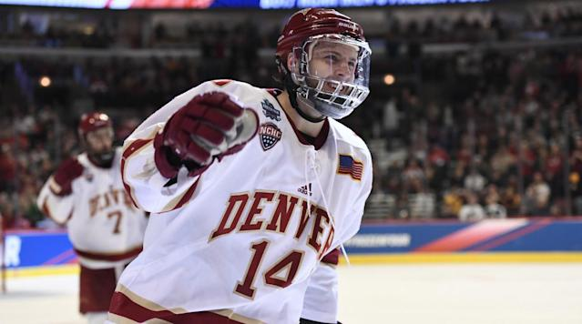 CHICAGO (AP) -- Jarid Lukosevicius scored three goals in the second period, and Denver beat Minnesota Duluth 3-2 on Saturday night for the NCAA championship.