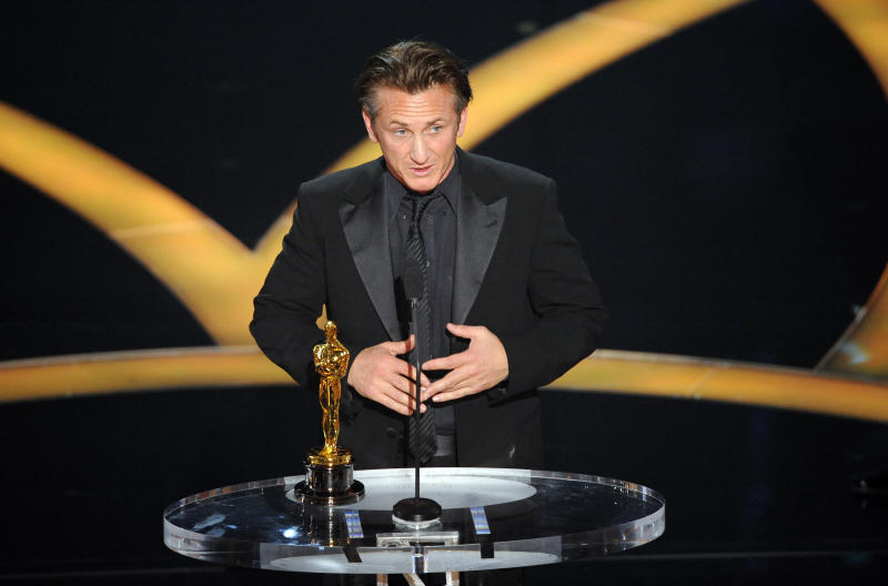 "Sean Penn accepts the Oscar for Best Actor for his work in ""Milk"" during the 81st Academy Awards on Sunday, Feb. 22, 2009. (Credit: AP Photo/Mark J. Terrill)"
