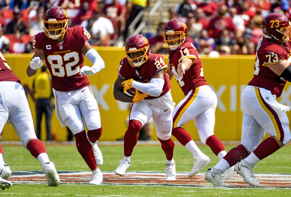 Washington Football Team running back Antonio Gibson carries the ball against the Los Angeles Chargers during the first quarter at FedExField. (Brad Mills/USA TODAY Sports)