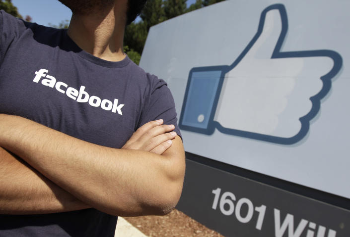 A Facebook worker waits for friends to arrive outside of Facebook headquarters in Menlo Park, Calif., Friday, Aug. 17, 2012. Facebook stock is trading at $19 and has lost half its market value since its May public offering. (AP Photo/Paul Sakuma)