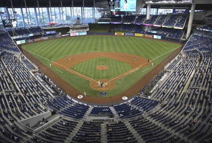 The Miami Marlins and the Tampa Bay Rays play during the second inning of a baseball game on opening day, Thursday, April 1, 2021, in Miami. (AP Photo/Gaston De Cardenas)