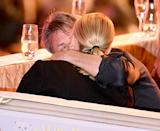 Sean Penn and Charlize Theron kiss during the Life Ball 2015 show at City Hall on May 16.