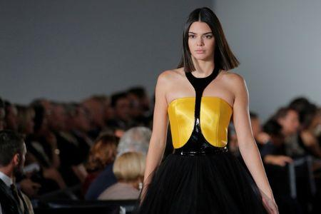 Model Kendall Jenner presents a creation from the Ralph Lauren Spring/Summer 2018 collection in a show that was presented in Lauren's private garage for New York Fashion Week in Manhattan, New York.