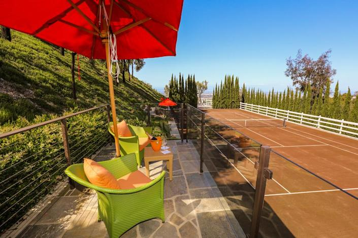 <p>Now we'll explore the grounds. Several spectator areas surround the clay tennis court. Situated on a hillside, it has both city and surf views. (Photo by Steve Brown/Sepia Productions)</p>