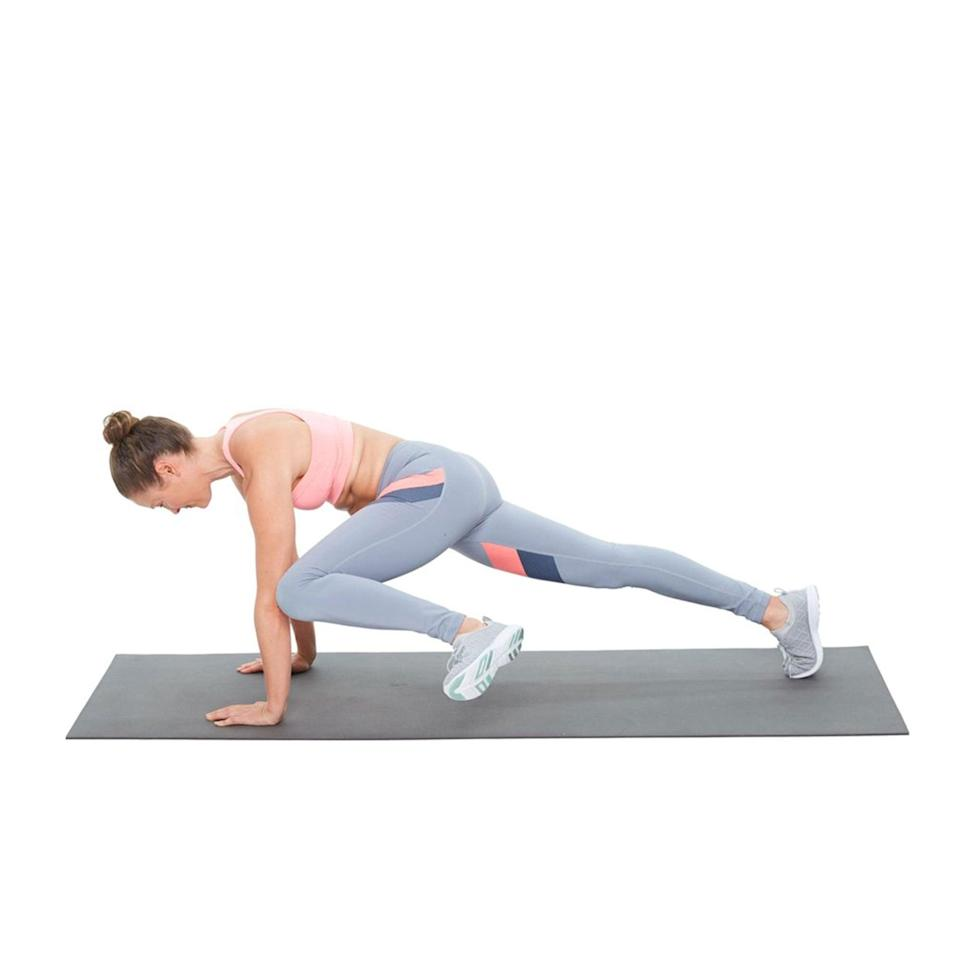 """<p>Roser recommended this challenging move, which combines a <a href=""""https://www.popsugar.com/fitness/How-Do-Creepy-Crawler-Plank-46335340"""" class=""""link rapid-noclick-resp"""" rel=""""nofollow noopener"""" target=""""_blank"""" data-ylk=""""slk:Spider-Man plank"""">Spider-Man plank</a> (aka Creepy Crawler) with a push-up for intense core engagement. It hits your obliques and abs while working your arms, too. You can modify by dropping down to your knees, Roser said.</p> <ul> <li>Start in high plank.</li> <li>Bring your left knee to your elbow while lowering into a push-up.</li> <li>Place your left foot back on the ground as you push back up into high-plank.</li> <li>Repeat on the other side to complete one rep.</li> </ul>"""