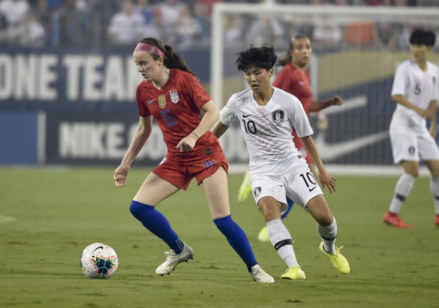 United States' Rose Lavelle (16) battles with South Korea's Ji So-yun (10) for the ball during a soccer match Thursday, Oct. 3, 2019, in Charlotte, N.C. (AP Photo/Mike McCarn)