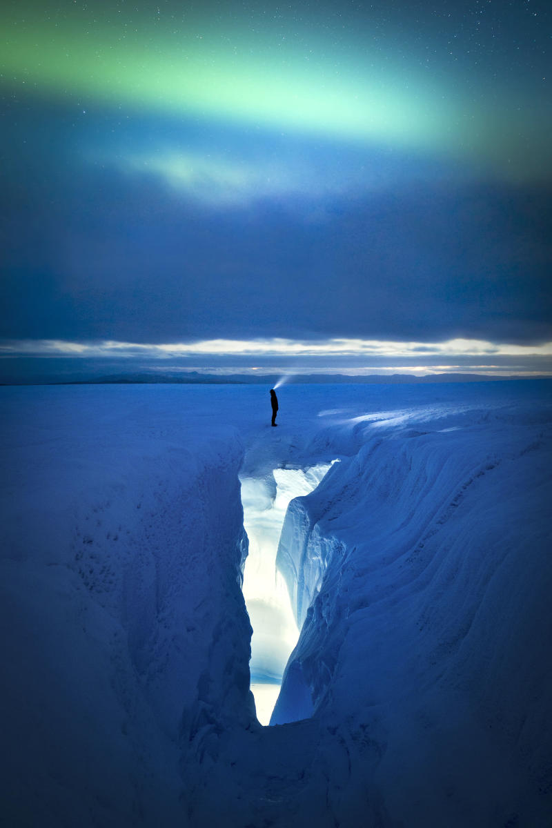 Ice crevasse and aurora, Greenland. (Photo: Paul Zizka/Caters News)