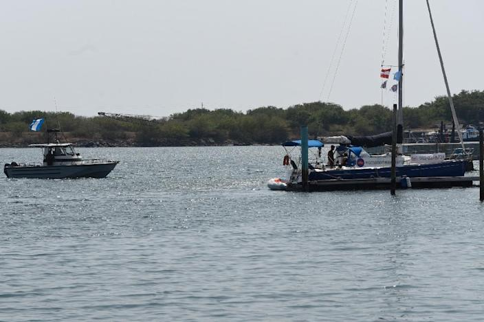 """An army boat approaches the """"abortion ship"""" of the Dutch organization Women on Waves at the Pez Vela Marina in the port of San Jose, Escuintla department, 120 km south of Guatemala City, on February 23, 2017 (AFP Photo/JOHAN ORDONEZ)"""