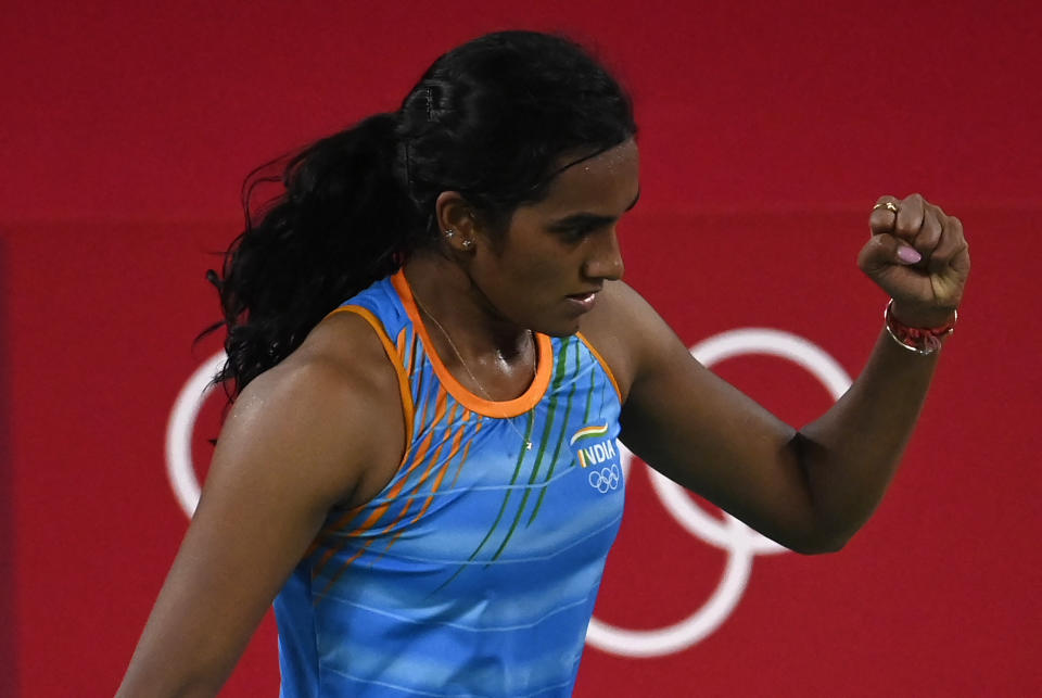 India's P. V. Sindhu reacts after a point against China's He Bingjiao in their women's singles badminton bronze medal match during the Tokyo 2020 Olympic Games at the Musashino Forest Sports Plaza in Tokyo on August 1, 2021. (Photo by Alexander NEMENOV / AFP) (Photo by ALEXANDER NEMENOV/AFP via Getty Images)