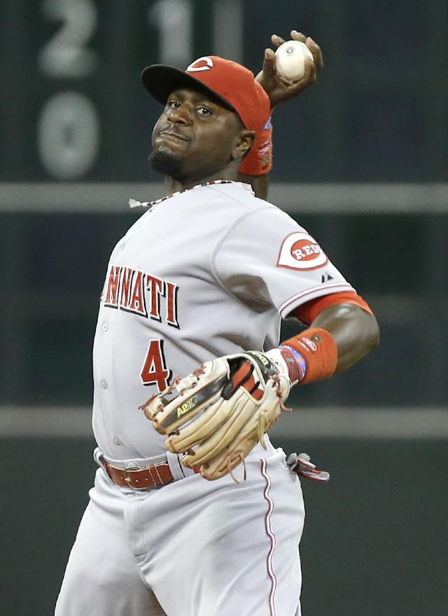 Cincinnati Reds second baseman Brandon Phillips fires the ball to first base for the out after fielding a grounder by Houston Astros' Jonathan Villar in the third inning of a baseball game Wednesday, Sept. 18, 2013, in Houston. (AP Photo/Pat Sullivan)