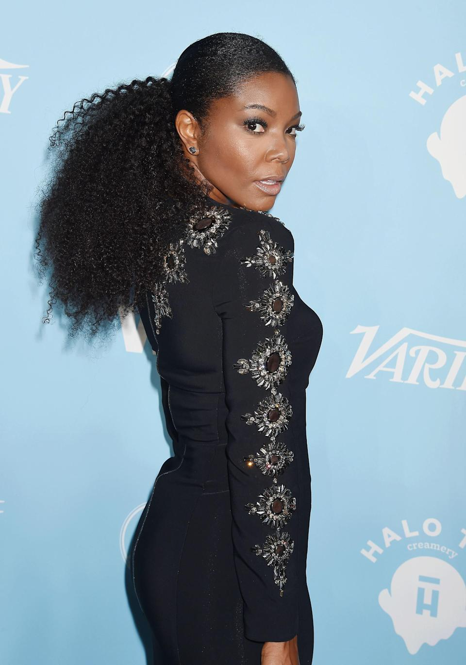 "Gabrielle Union has never made a hair misstep in her life, and this kinky pony is no exception. Run a <a href=""https://www.glamour.com/story/best-hair-gel-for-curls?mbid=synd_yahoo_rss"" rel=""nofollow noopener"" target=""_blank"" data-ylk=""slk:strong-hold gel"" class=""link rapid-noclick-resp"">strong-hold gel</a> through your crown for that smooth, shiny finish, and let your kinks balloon to their fullest."