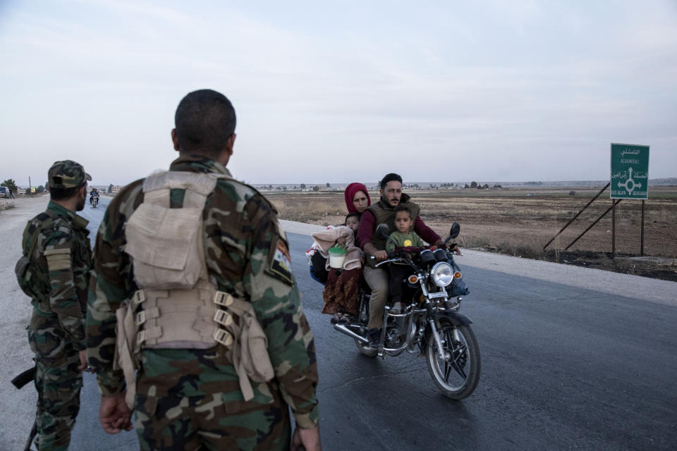 Syrian government troops man a checkpoint town of Tal Tamr in northeast Syria, Monday, Oct. 14, 2019. Syrian government troops moved into towns and villages in northern Syria on Monday, setting up a potential clash with Turkish-led forces advancing in the area as long-standing alliances in the region begin to shift or crumble following the pullback of U.S. forces. (AP Photo/Baderkhan Ahmad)