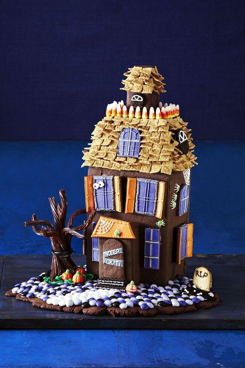 """<p>Why wait until Christmas to make a cookie house? This haunted cookie house also includes an assortment of cookies, candies, and chocolate.</p><p><em><strong><strong><em><a href=""""https://www.womansday.com/food-recipes/food-drinks/g1658/halloween-haunted-cookie-house/"""" rel=""""nofollow noopener"""" target=""""_blank"""" data-ylk=""""slk:Get the Haunted Gingerbread House recipe."""" class=""""link rapid-noclick-resp"""">Get the Haunted Gingerbread House recipe. </a></em></strong></strong></em></p>"""