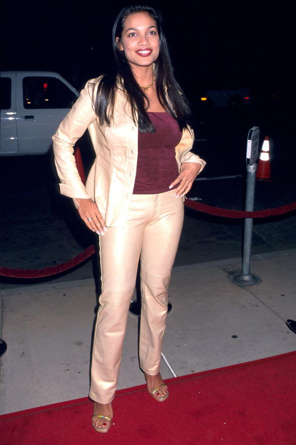 <p>At the <em>Light It Up </em>film premiere, Rosario wore a metallic suit with a burgundy top, which happened to match her lipstick color perfectly.</p>