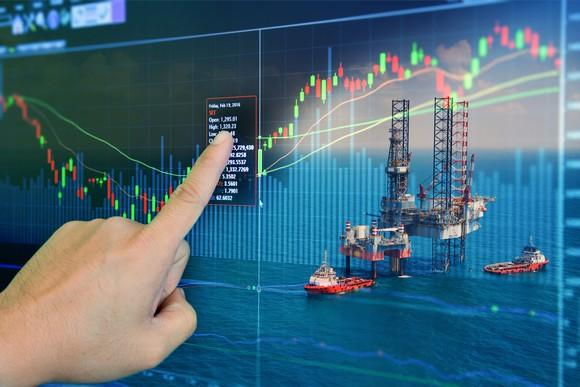 Oil rigs superimposed on a stock chart.