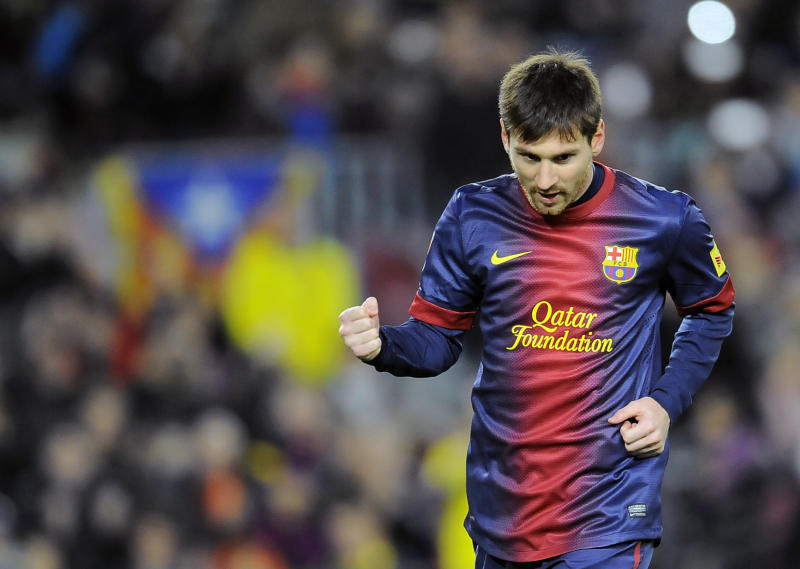Barcelona's Lionel Messi from Argentina, right, celebrates after scored against Osasuna during their Spanish League soccer match, at Camp Nou stadium in Barcelona, Spain, Sunday, Jan. 27, 2013. Barcelona won the match 5-1. (AP Photo/Alvaro Barrientos)