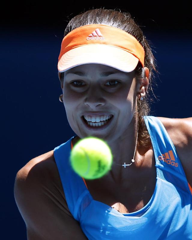 Ana Ivanovic of Serbia eyes the ball for a shot to Eugenie Bouchard of Canada during their quarterfinal at the Australian Open tennis championship in Melbourne, Australia, Tuesday, Jan. 21, 2014.(AP Photo/Aaron Favila)