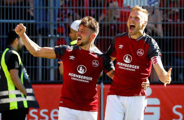 Soccer Football - 2. Bundesliga - SV Sandhausen v Nuremberg - BWT-Stadion am Hardtwald, Sandhausen, Germany - May 6, 2018 Nurnberg 's Tim Leibold celebrates scoring their second goal REUTERS/Kai Pfaffenbach DFL RULES TO LIMIT THE ONLINE USAGE DURING MATCH TIME TO 15 PICTURES PER GAME. IMAGE SEQUENCES TO SIMULATE VIDEO IS NOT ALLOWED AT ANY TIME. FOR FURTHER QUERIES PLEASE CONTACT DFL DIRECTLY AT + 49 69 650050