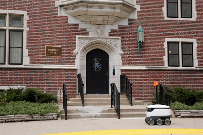 A Starship Technologies robot drives past Duhme Hall on First st., Thursday, Aug. 8, 2019 in West Lafayette. The self-driving delivery robot is mapping the Purdue campus according to an employee.