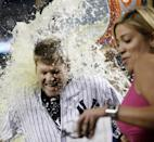 New York Yankees Chase Headley reacts as he is doused with Gatorade after hitting a game-winning, 14th-inning, walk-off RBI single in the Yankees 2-1 victory over the Texas Rangers in a baseball game at Yankee Stadium in New York, Wednesday, July 23, 2014. YES Network announcer Meredith Marakovits backs away, right. (AP Photo)