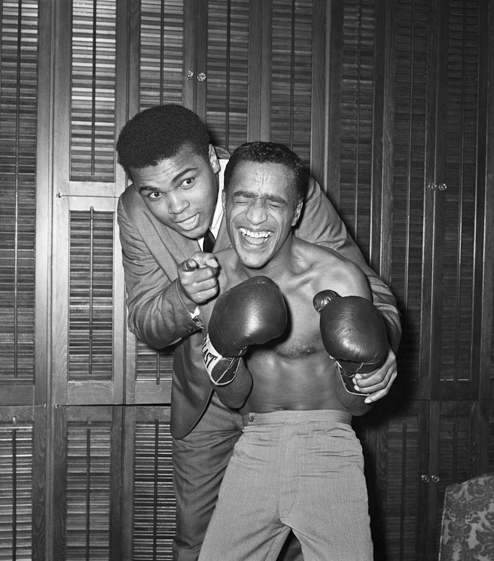 <p>Sammy Davis Jr. (right) receives a pep talk from Heavyweight Champion Cassias Clay (left) before heading out for a celebrity boxing match, January 14, 1965.</p>