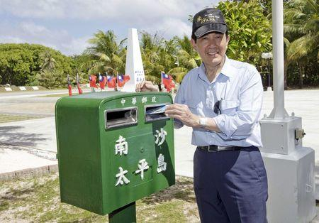 Taiwan's President Ma Ying-jeou mails a letter on the disputed Itu Aba or Taiping island in the South China Sea, January 28, 2016. REUTERS/Chen Chien Hsing/Presidential Office/Handout