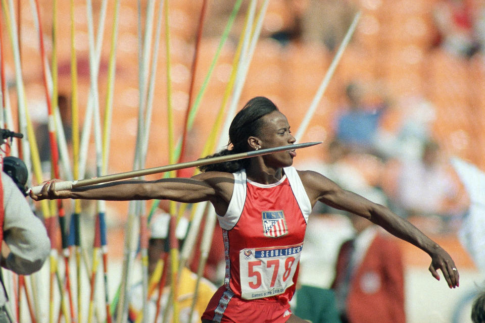 FILE - In this Sept. 24, 1988, file photo, Jackie Joyner-Kersee of East St. Louis, Ill., makes her javelin throw during heptathlon competition at the Seoul Olympics in South Korea. (AP Photo/Lennox McLendon, File)