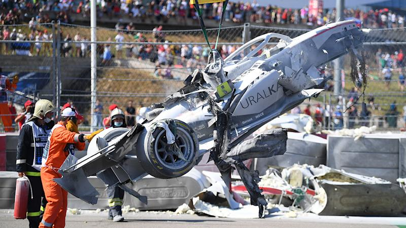 Track marshals, pictures here clearing the debris after a crash between Jack Aitken and Luca Ghiotto.