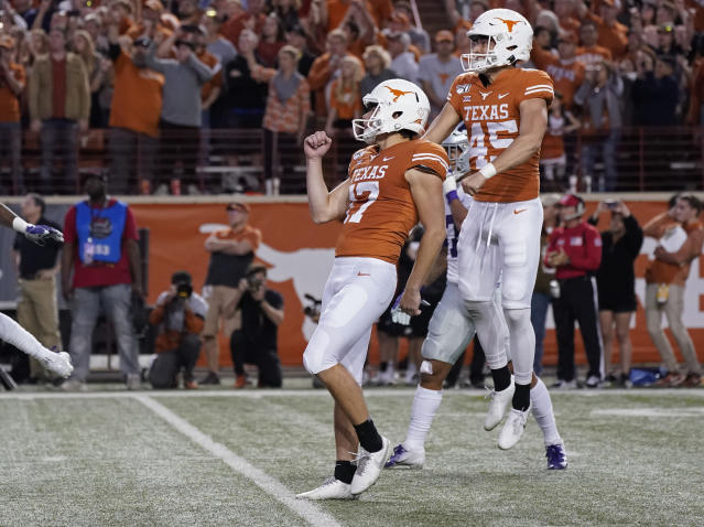 Texas' Cameron Dicker (17) and Chris Naggar (45) celebrate Dicker's last-second winning field goal against Kansas State during the second half of an NCAA college football game in Austin, Texas, Saturday, Nov. 9, 2019. (AP Photo/Chuck Burton)