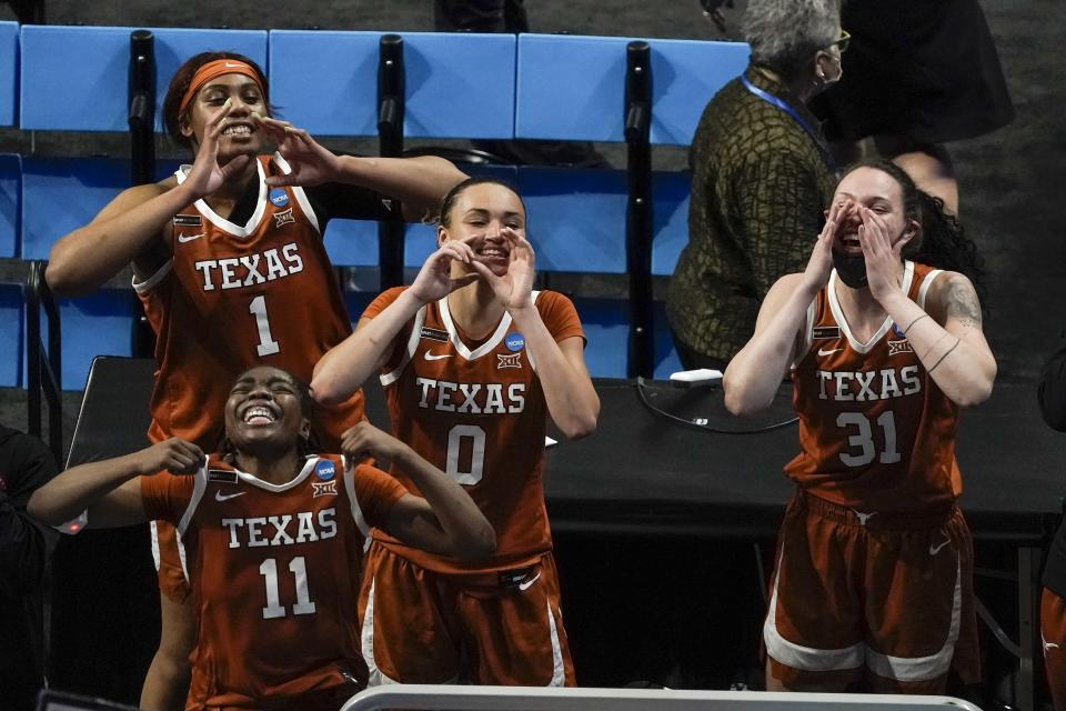Texas's Lauren Ebo (1), Joanne Allen-Taylor (11), Celeste Taylor and Audrey Warren celebrate after an NCAA college basketball game against Maryland in the Sweet 16 round of the Women's NCAA tournament Sunday, March 28, 2021, at the Alamodome in San Antonio. Texas won 64-61. (AP Photo/Morry Gash)