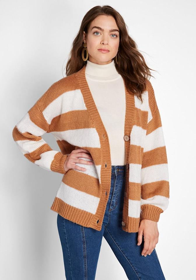 "<p>We love the Fall vibes of this cute <a href=""https://www.popsugar.com/buy/Modcloth-Striped-Commitment-Cardigan-489195?p_name=Modcloth%20Striped%20Commitment%20Cardigan&retailer=modcloth.com&pid=489195&price=69&evar1=fab%3Aus&evar9=43813917&evar98=https%3A%2F%2Fwww.popsugar.com%2Ffashion%2Fphoto-gallery%2F43813917%2Fimage%2F46597805%2FModcloth-Striped-Commitment-Cardigan&list1=shopping%2Cfall%20fashion%2Csweaters%2Cfall&prop13=mobile&pdata=1"" rel=""nofollow"" data-shoppable-link=""1"" target=""_blank"" class=""ga-track"" data-ga-category=""Related"" data-ga-label=""https://www.modcloth.com/shop/tops/striped-commitment-cardigan-in-yellow-stripe/166709.html"" data-ga-action=""In-Line Links"">Modcloth Striped Commitment Cardigan</a> ($69).</p>"