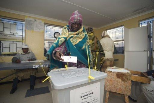 A Basotho man casts his vote at a polling station some 20kms outside Maseru