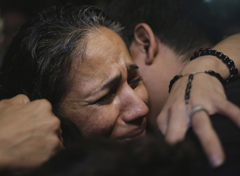 Cassandra Rivera is greeted by family members after she, Elizabeth Ramirez and Kristie Mayhugh were released from the Bexar County Jail, Monday, Nov. 18, 2013, in San Antonio, after it was announced earlier in the day the women imprisoned for sexually assaulting two girls in 1994 were allowed to walk free after a judge agreed that their convictions were tainted by faulty witness testimony. (AP Photo/Eric Gay)