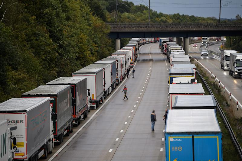 ASHFORD, ENGLAND - SEPTEMBER 24: Lines of heavy goods vehicles and cargo lorries are seen queued along the M20 motorway as part of the Operation Stack traffic control plan, on September 24, 2020 near Ashford, England. Due to industrial action in Calais, vehicles were backed up along the motorway to prevent overcrowding and gridlock in the port of Dover. (Photo by Leon Neal/Getty Images)