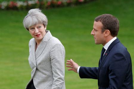 FILE PHOTO: French President Emmanuel Macron (R) escorts Britain's Prime Minister Theresa May after they spoke to the press at the Elysee Palace in Paris, France, June 13, 2017.    REUTERS/Philippe Wojazer/File Photo