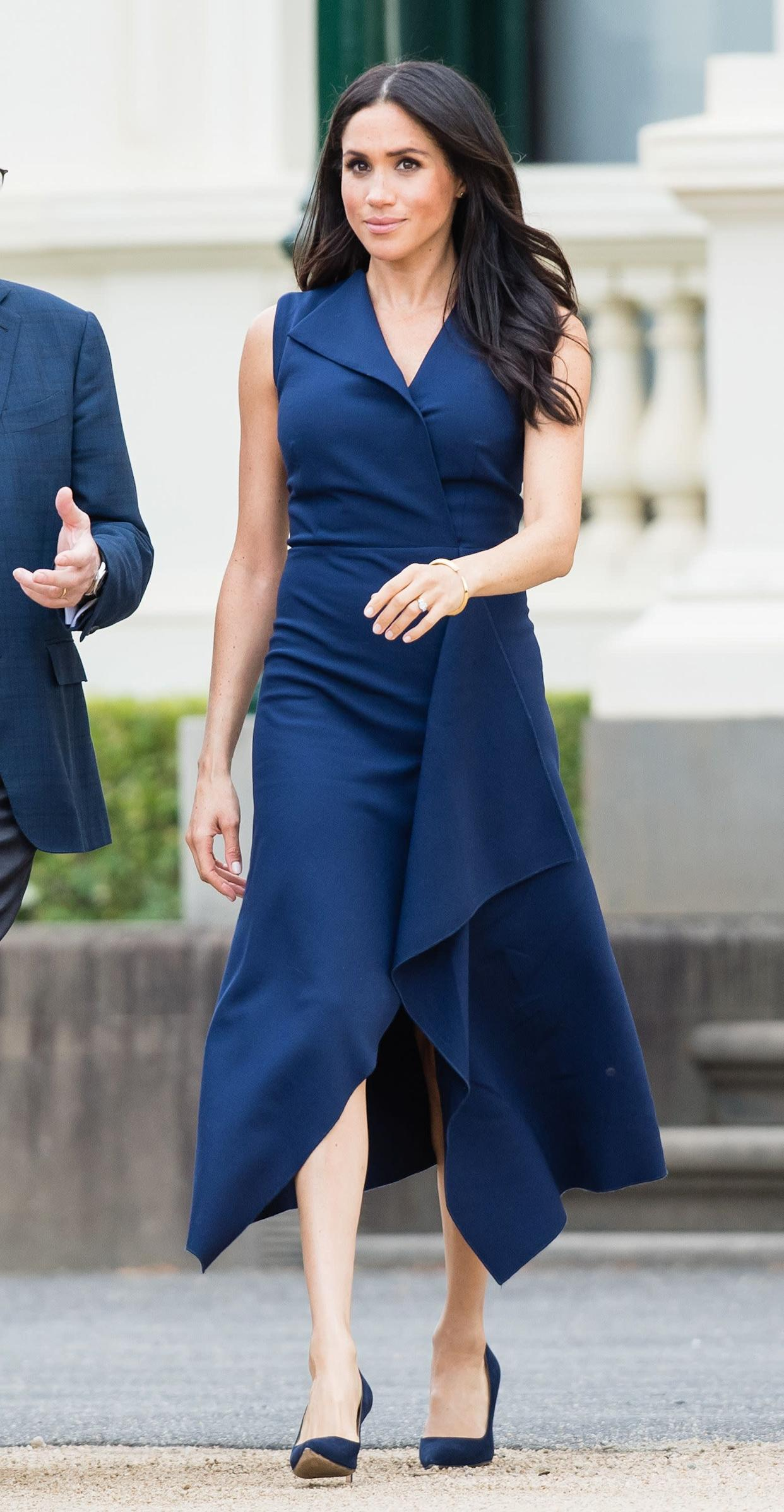 "The duchess wears a <a href=""https://global.dionlee.com/shop/dion-lee/new-/folded-sail-dress-a9564-p19/281031"" rel=""nofollow noopener"" target=""_blank"" data-ylk=""slk:Dion Lee dress"" class=""link rapid-noclick-resp"">Dion Lee dress</a> on Oct. 18, day three of the royal tour. The dress, which costs $990, is currently available for preorder."