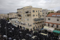 Thousands of ultra-Orthodox Jews participate in the funeral of prominent rabbi Meshulam Soloveitchik, flouting the country's ban on large public gatherings amid the pandemic, in Jerusalem, Sunday, Jan. 31, 2021. The mass ceremony took place despite the country's health regulations banning large public gatherings, during a nationwide lockdown to curb the spread of the virus. (AP Photo/Ariel Schalit)