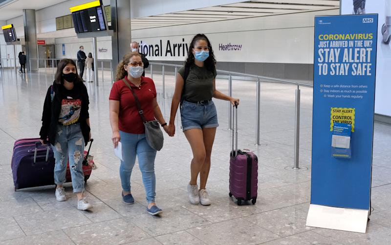 Passengers on a flight from Madrid arrive at Heathrow Airport, following an announcement on Saturday that holidaymakers who had not returned from Spain and its islands by midnight would be forced to quarantine for 14 days after Covid-19 second wave fears saw the European country struck off the UK's safe list. The decision was made after Spain recorded more than 900 fresh daily Covid-19 cases for two days running. (Photo by Andrew Matthews/PA Images via Getty Images)
