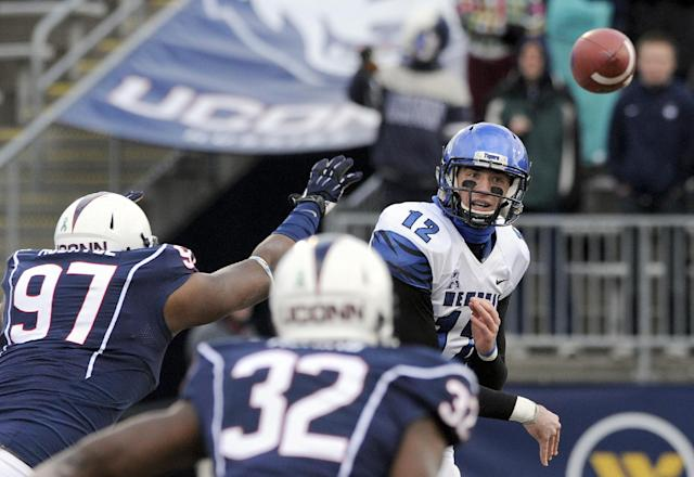 Memphis quarterback Paxton Lynch (12) passes while pressured by Connecticut defensive end B.J. McBryde (97) and Connecticut linebacker Jefferson Ashiru (32) during the first half of an NCAA college football game in East Hartford, Conn., on Saturday, Dec. 7, 2013. (AP Photo/Fred Beckham)