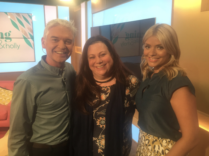 Sarah Bowles (centre) pictured with 'This Morning' presenters Phillip Schofield and Holly Willoughby in 2016. (Supplied)