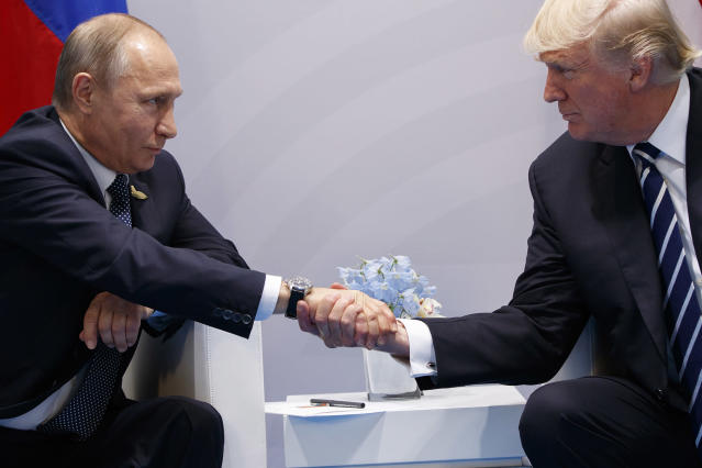 <p>President Donald Trump shakes hands with Russian President Vladimir Putin at the G20 Summit, Friday, July 7, 2017, in Hamburg, Germany. (Photo: Evan Vucci/AP) </p>