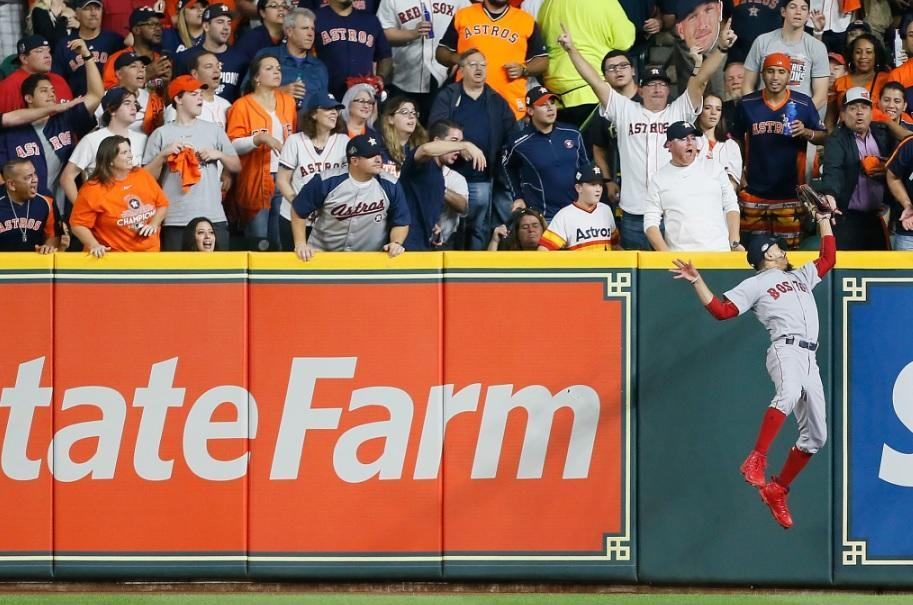 Red Sox right fielder Mookie Betts clearly and cleanly robs the Astros Alex Bregman of a home run in ALCS Game 5. (Getty Images)