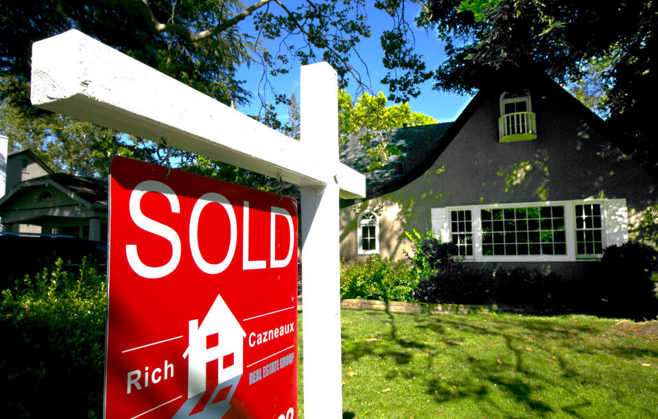 In this photo taken Wednesday, July 5, 2017 a sold sign is displayed in front of a house in Sacramento, Calif. The state Senate approved a measure, SB2, by Sen. Toni Atkins, D-San Diego, Thursday, July 6, 2017, that imposes  a $75 fee on real estate transaction documents such as deeds and notices with a cap of $225 per transaction. The fee is expected to generate between $200 and $300 million annually for affordable housing projects. The bill now goes to the Assembly. (AP Photo/Rich Pedroncelli)