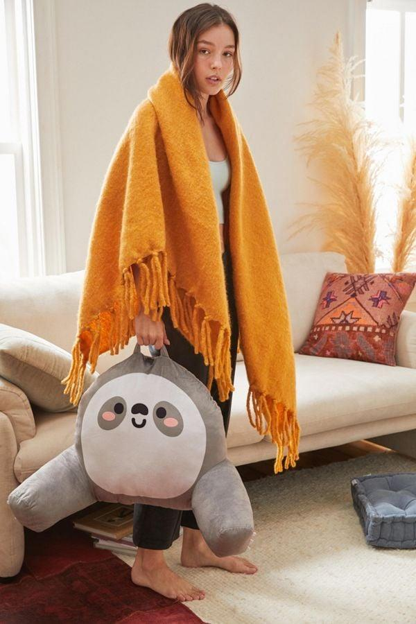 """<p>This <a href=""""https://www.popsugar.com/buy/Smoko-Plush-Vibrating-Boo-Pillow-485256?p_name=Smoko%20Plush%20Vibrating%20Boo%20Pillow&retailer=urbanoutfitters.com&pid=485256&price=49&evar1=savvy%3Aus&evar9=45317349&evar98=https%3A%2F%2Fwww.popsugar.com%2Fsmart-living%2Fphoto-gallery%2F45317349%2Fimage%2F46696056%2FSmoko-Plush-Vibrating-Boo-Pillow&list1=shopping%2Cgifts%2Choliday%2Chumor%2Cgift%20guide%2Cwhite%20elephant%20gifts&prop13=mobile&pdata=1"""" rel=""""nofollow"""" data-shoppable-link=""""1"""" target=""""_blank"""" class=""""ga-track"""" data-ga-category=""""Related"""" data-ga-label=""""https://www.urbanoutfitters.com/shop/smoko-plush-vibrating-boo-pillow?category=home&amp;color=005"""" data-ga-action=""""In-Line Links"""">Smoko Plush Vibrating Boo Pillow</a> ($49) is great for lying on the floor.</p>"""