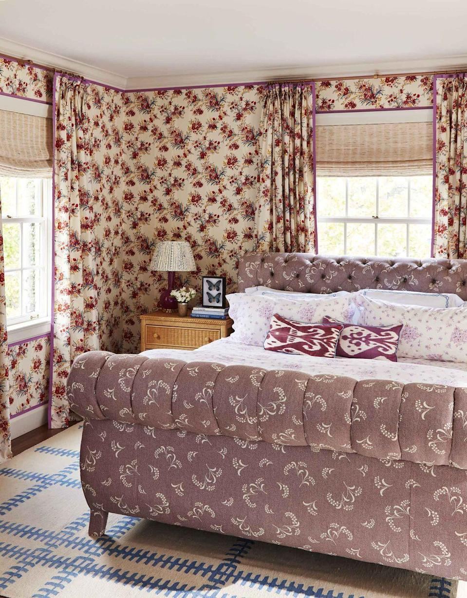 """<p>In her own bedroom, designer Caroline Gidiere paired deep rose floral wallcovering (<a href=""""https://www.decorsbarbares.com/"""" rel=""""nofollow noopener"""" target=""""_blank"""" data-ylk=""""slk:Décors Barbares"""" class=""""link rapid-noclick-resp"""">Décors Barbares</a>) with a soft lilac linen (<a href=""""http://www.carolinairvingtextiles.com/"""" rel=""""nofollow noopener"""" target=""""_blank"""" data-ylk=""""slk:Carolina Irving Textiles"""" class=""""link rapid-noclick-resp"""">Carolina Irving Textiles</a>) custom upholstered bed. Linens, <a href=""""https://dporthaultparis.com/"""" rel=""""nofollow noopener"""" target=""""_blank"""" data-ylk=""""slk:D. Porthault"""" class=""""link rapid-noclick-resp"""">D. Porthault</a></p>"""