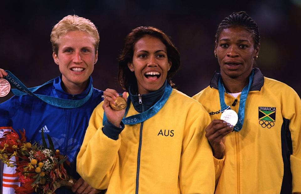 Cathy Freemnan holding the gold medal during the Sydney Olympic Games.