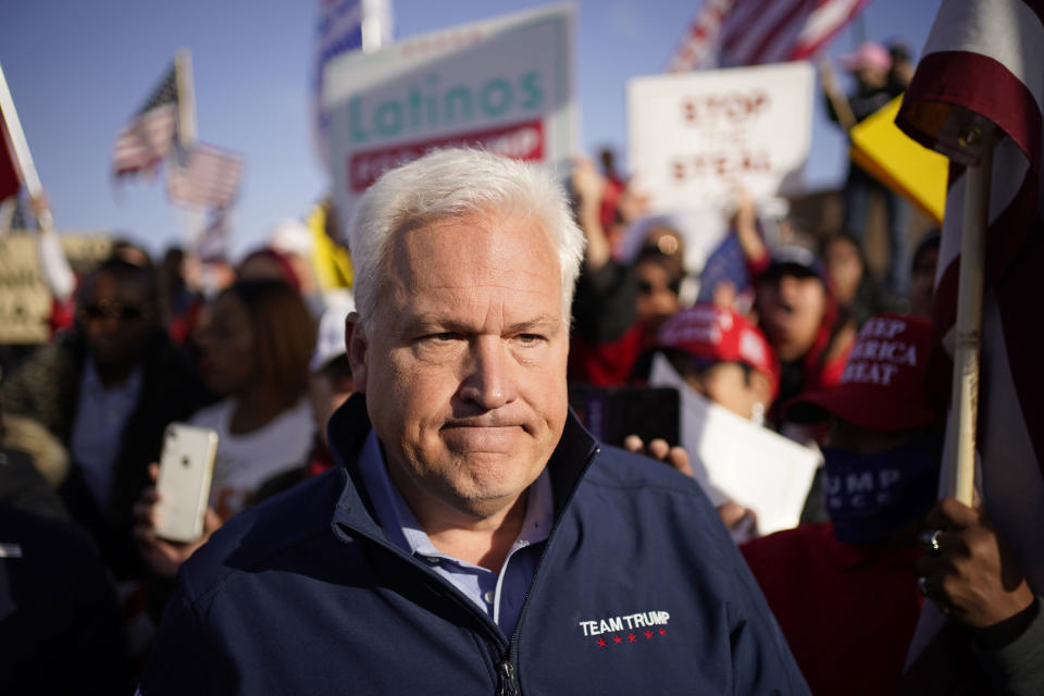 FILE - In this Nov. 8, 2020, file photo, Matt Schlapp, chairman of the American Conservative Union, leaves after speaking at a news conference outside of the Clark County Election Department in North Las Vegas. The shadow of 2020 will likely figure into the Senate race in Nevada, where state legislators passed a law in May to send all voters mail-in ballots in future elections. Republican Adam Laxalt referenced election integrity while former Trump cabinet member Ric Grenell and Schlapp repeated their claims about voter fraud and Trump winning Nevada in the 2020 election without evidence. (AP Photo/John Locher, File)