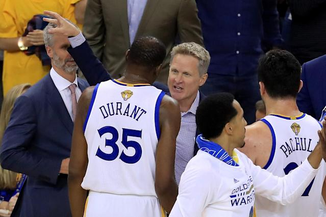 Steve Kerr speaks with Kevin Durant on the bench during Game 2 of the 2017 NBA Finals. (Ronald Martinez/Getty Images)